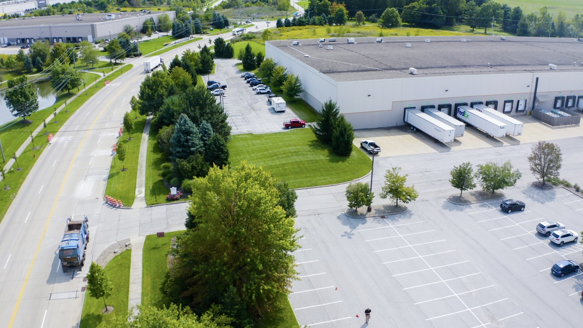Commercial warehouse parking lot and landscape