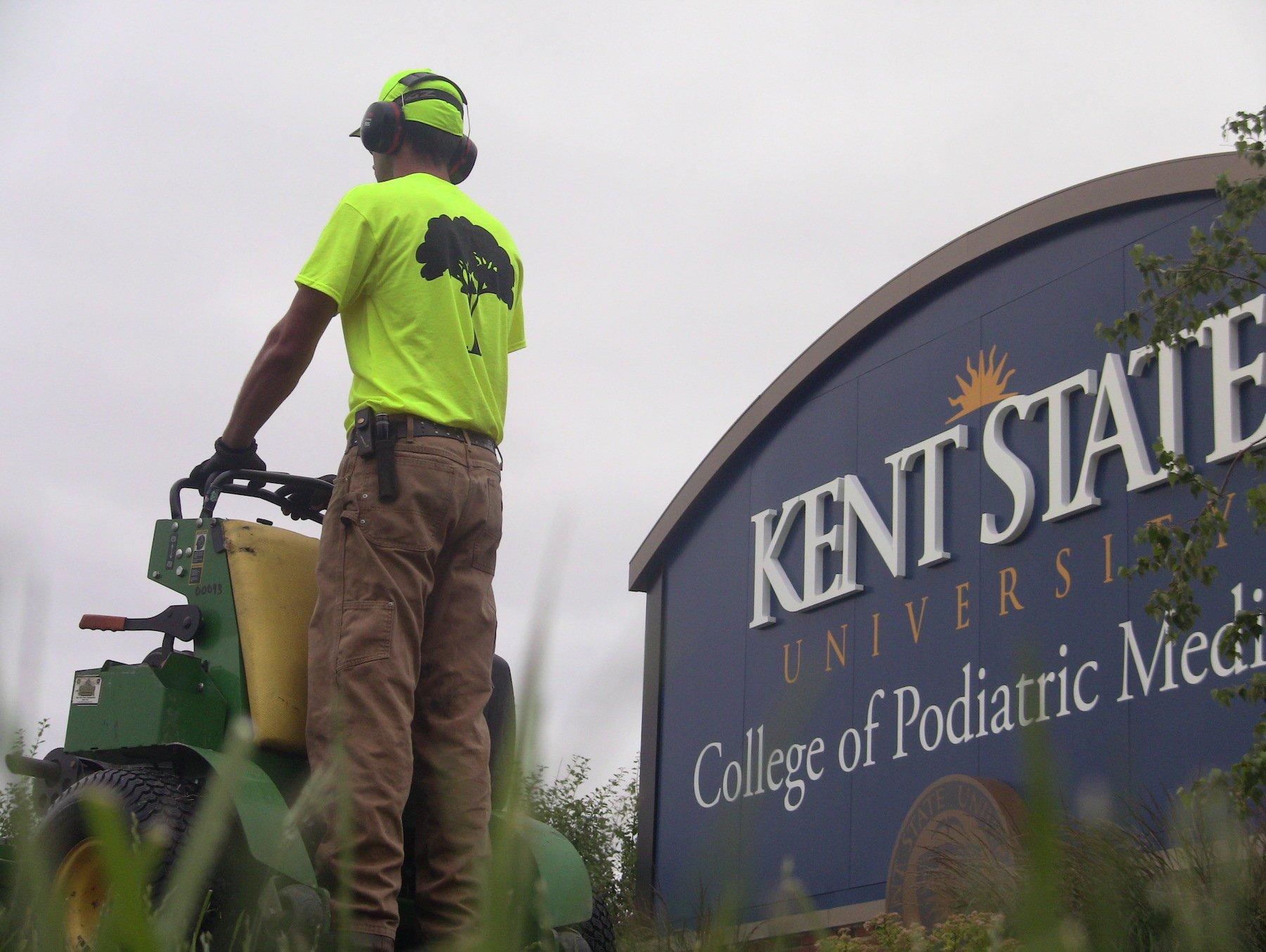 crew-mowing-signage-campus-college-university-2