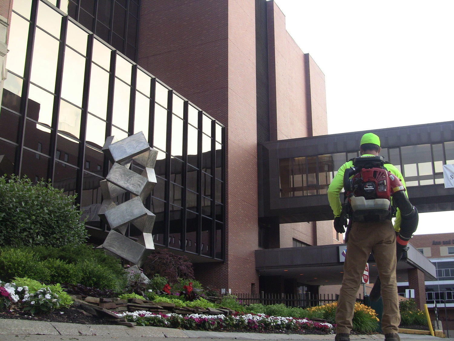 Lawn care technician cleaning up at a hospital