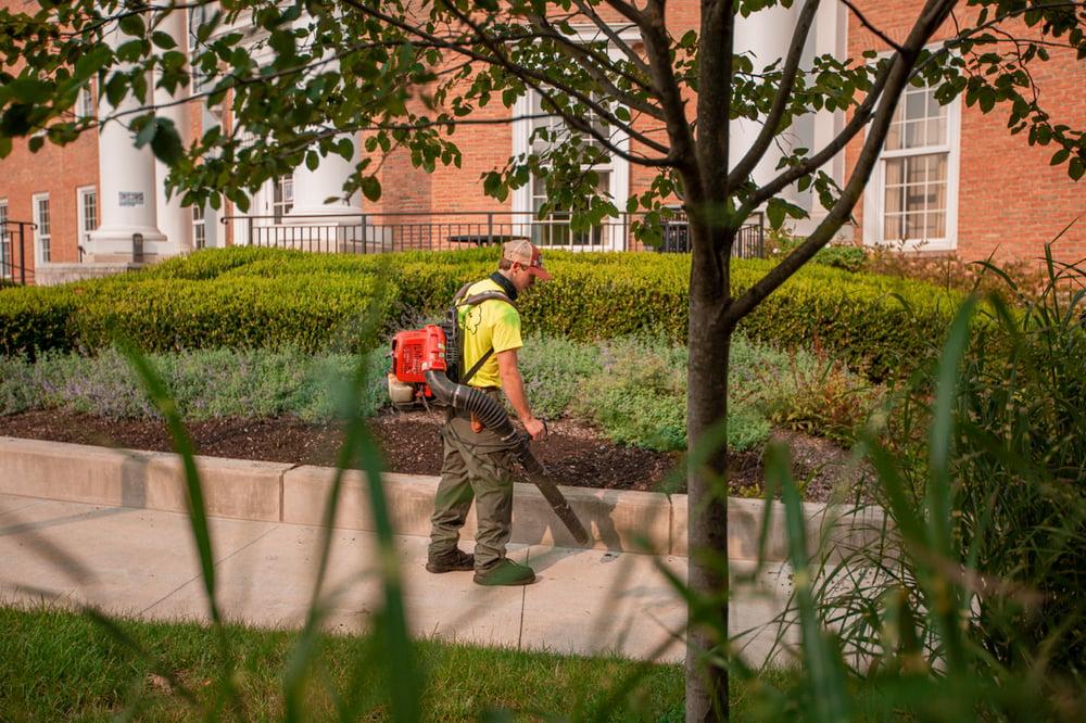 Commercial Landscaping Crew Leaf Blower shrubs walkway sidewalk