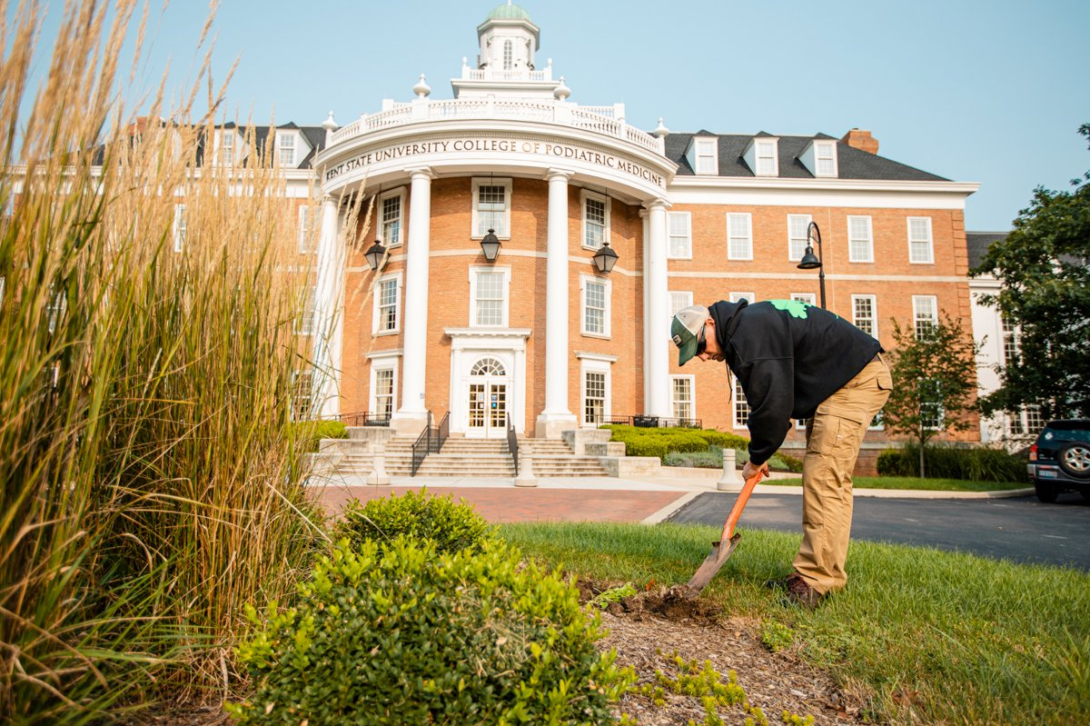 Landscape maintenance crew working in the gardens bed