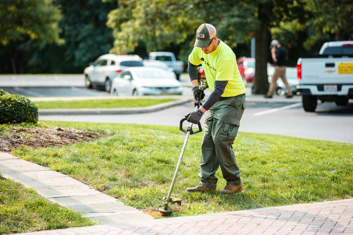 Commercial Landscaping Crew Maintenance trimming sidewalks