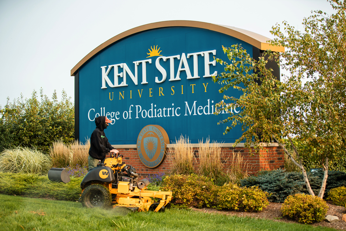 Commercial Landscaping Crew Mowing at Kent State University College