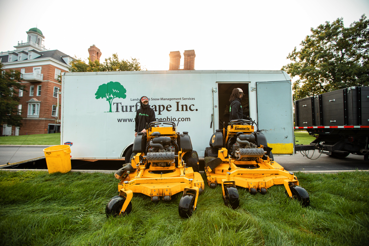 Lawn care technicians getting ready to mow