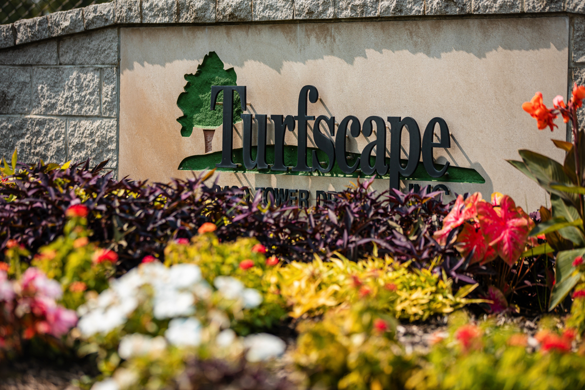 Turfscape sign with colorful flowers