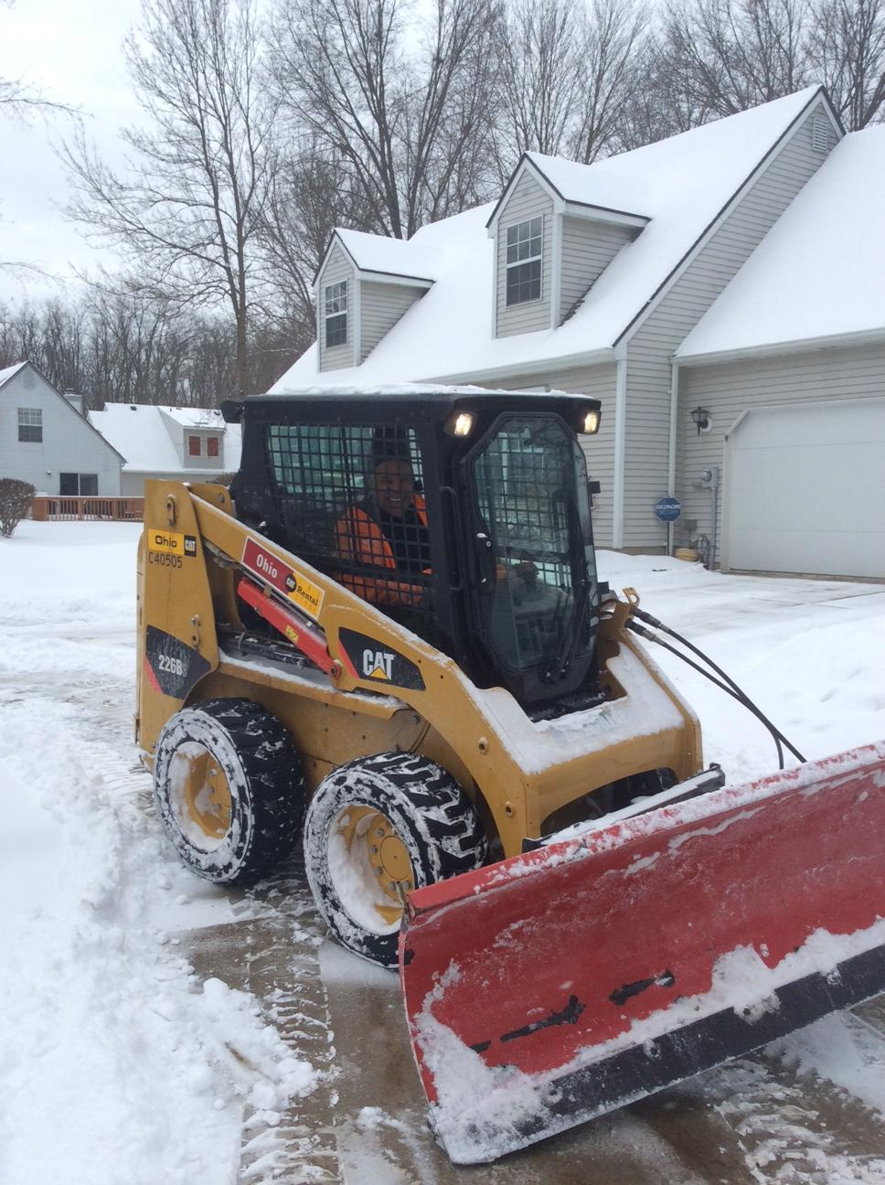 skid loader to remove snow