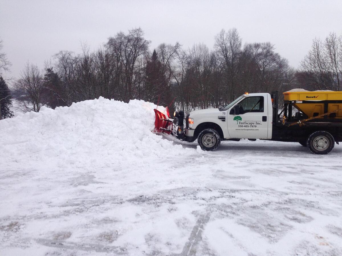 snowplow and truck move snow in ohio