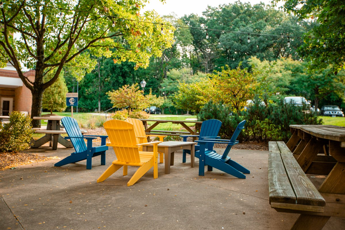 outdoor classroom seating area with trees for covering