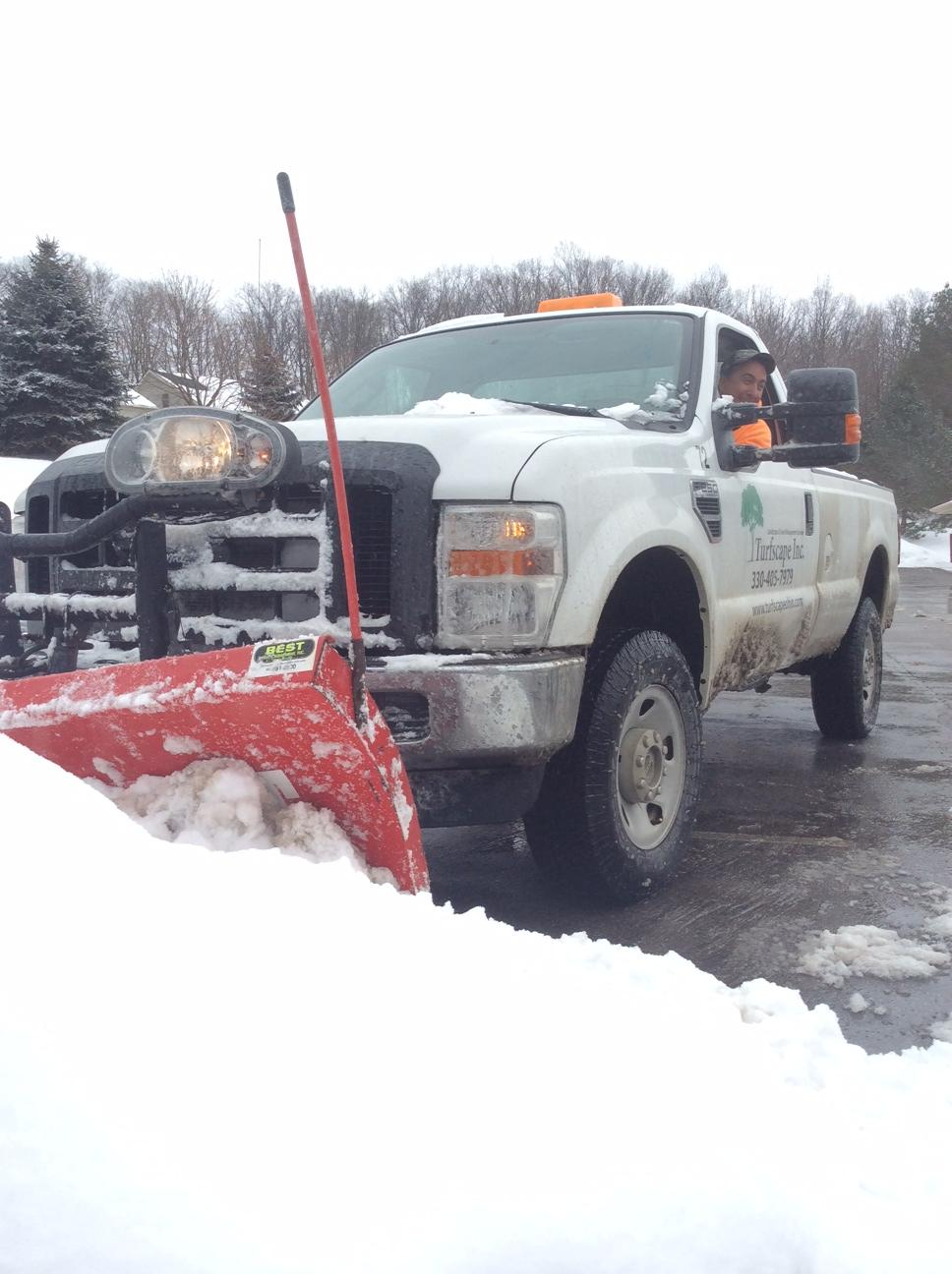 Turfscape crew performing snow removal