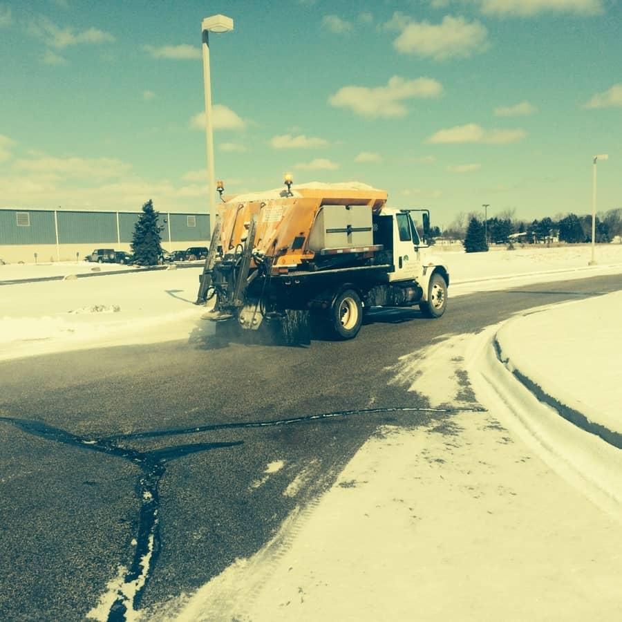 turfscape truck lays salt on roadway