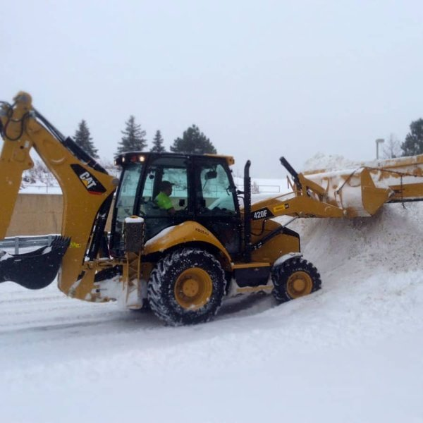 commercial snow plowing - back hoe