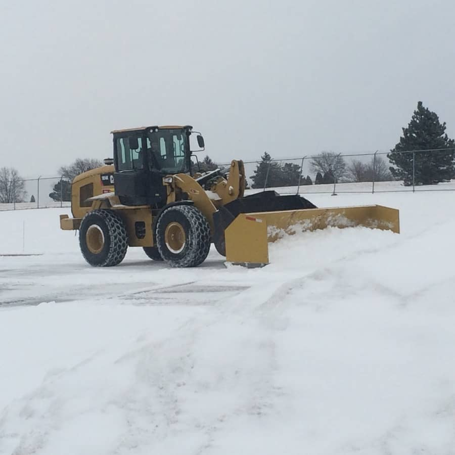 commercial snow plowing services - loader