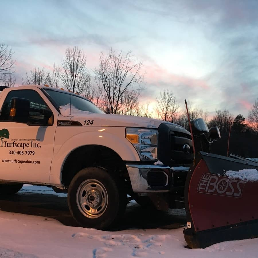 commercial snow plowing services - plow truck