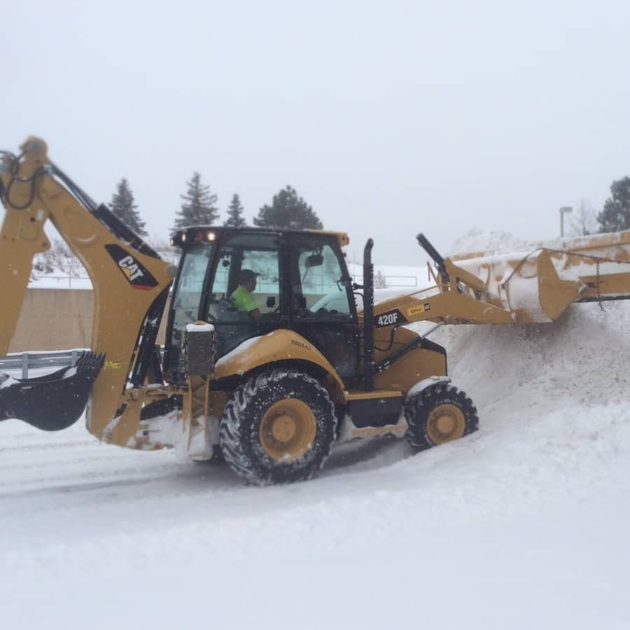 commercial snow plowing services - back hoe